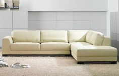 Contemporary style sleek high quality full ivory leather corner. The Right Facing Corner features simple and attractive design. Sleek corners, spacious backs looks comfortable and relaxing. This simple yet modern style corner features full ivory leather on the bottom, backs and seats. Wenge wood leg...
