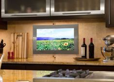Kitchen With LCD TV Mounted In Tehe Backsplash