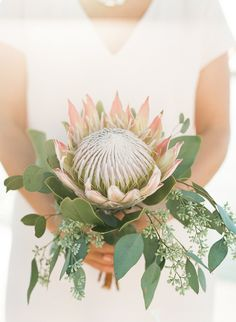 king protea. planning + decor/design by @petitepearl + bouquet by @celsiafloral.
