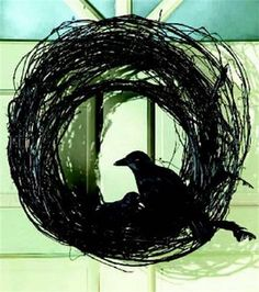 For the base of a Halloween wreath:  Spray paint a standard grapevine wreath from the craft store black