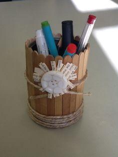 Tin, pop sticks and string to make a stationary holder