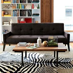 LOVE THIS PIN TUCK COUCH that also lies flat like to a daybed (like a futon) for guests <3  of course...from west elm