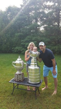 Andrew Desjardins takes a family photo with his wife and son during his Cup Day! #StanleyCup #Blackhawks