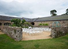 Barn courtyard laid out for wedding ceremony