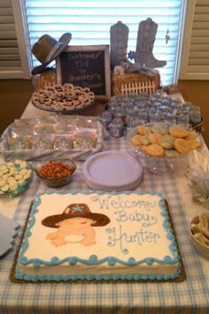 Cowboy baby shower cake ...body is made from fondant and the hat and diaper is star tip icing