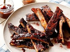 Neelys' 25 Top-Rated Recipes - Neely's BBQ Pork Spare Ribs - These classic spare ribs are first dry rubbed with paprika, sugar, and onion powder, then lathered with the Neely's famous BBQ sauce and grilled to perfection.