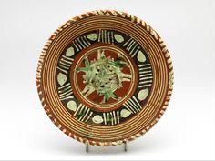 dish , c. 1600 h. 3.5 x diam. 24 cm slip decoration, lead glaze, redware, copper oxide, manganese (Europe > Western Europe > The Netherlands > South Holland > Leiden)