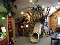 slide in the waiting room of pediatric dentist office -- super cool theming of a dental office. cool spaces for children. Medical Office Decor, Dental Office Design, Office Designs, Design Offices, Modern Offices, Healthcare Design, Artificial Indoor Trees, Kids Office, Office Ideas