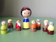 Snow White and the Seven Dwarfs peg dolls dolls by BambiniToys