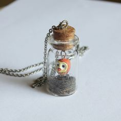 Baby Owl Necklace in a Bottle.  See this cute baby owl hanging here and there playing inside the bottle. It will be a great addition for you who looks for an extraordinary necklace. This could be a great necklace for someone who loves animals. Be different, be unique and be magical with this Baby Owl Necklace.  Here are some owl symbol meanings for your knowledge : Wisdom Mystery Femininity Messages Intelligence Mysticism Protection Secrets  ***************** Bottle size: Tall : 4.5 cm / 1.7…