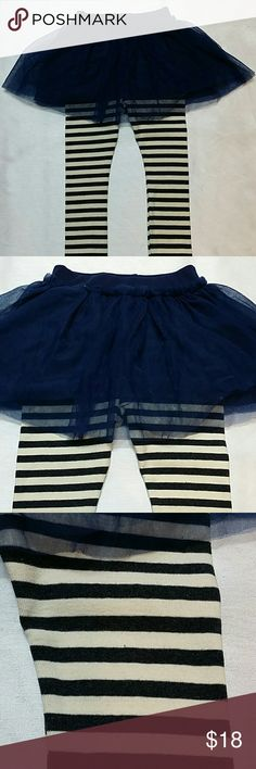 NWOT Blue Tull Skort and striped legging.  Size 5T Adorable dark blue skort made from tulle on the outside layer and a dark blue fabric inside.  The attached legging are striped.  Fits 4T - 5T  Very cute item.  This item is brand new and never used Bottoms Skorts