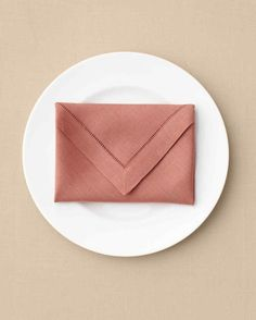 Envelope Napkin Ways to Fold a Napkin | Martha Stewart Living — Simple yet sophisticated, this design is perfect for sealing a printed menu, a party favor, or ... who knows? It's up to you.