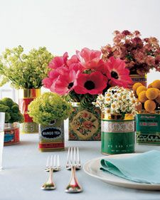 "Use old, decorative tins as vases for an eclectic look. 1 flower type per ""vase"" helps."