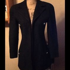 REDUCEDBloomingdales black blazer Wool blend fully lined.  Gold & black buttons on pockets.  Just lays flat on the front, no buttons or hooks. Great condition. Bloomingdale's Jackets & Coats Blazers