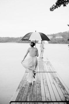 bride in rain with umbrella