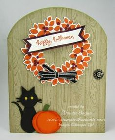 Stampin' Up! hadmade Halloween card ... Wondrous Wreath in oranges on an arched door shaped card ... luv the woodgrain background ... black cat and pumpkin sitting in front ... like it!