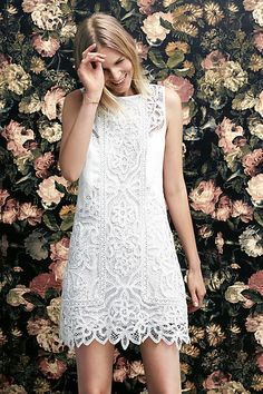 The intricate white lace detailing of our Perla Lace Shift Dress adds a touch of formality making it a go-to outfit for something like a summer race event.