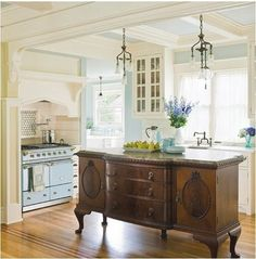 use an antique dresser as an island in your kitchen