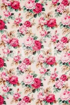 Antique floral fabric with clusters of pink and flowers on a beige background.