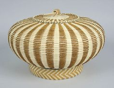 https://flic.kr/p/9r6N68 | Jeremy Frey Cedar Urchin | Jeremy Frey, Passamaquoddy, 2007  This basket exemplifies the innovation seen in Jeremy's work. Here, he has replaced what would traditionally have been braided sweetgrass with braided cedar bark, and accents his basket with a weaving technique, seen on the base ring, learned from Native Hawaiian weavers.