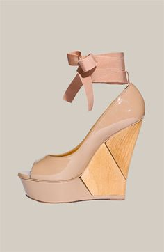 Platform wedges with a peep toe AND ankle strap. And a bow.