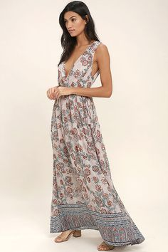 Lulus Exclusive! Let the Wings of Fancy Blush Pink Floral Print Maxi Dress carry you away to a magical place! Woven poly, with a rust red, blue, and white floral print, forms wide straps (with no-slip strips) that flow into a plunging surplice bodice (with modesty snap). Sweeping maxi skirt falls below an elasticized waist with tassel ties at the sides.