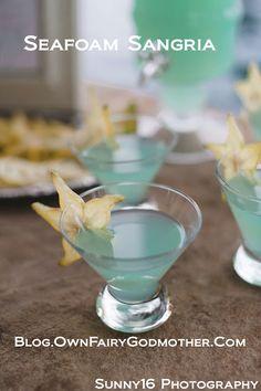 Seafoam Sangria: 3 parts white wine,   2 parts blue Hpnotiq Liquer,   1 part Ginger Ale