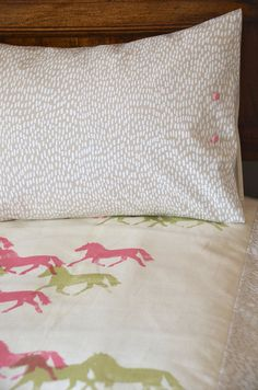 cot quilt screen printed in pink brumby and white dashes print on organic cotton/ hemp fabric