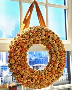 Wreath made of sweetgum fruit.  Paint in shades of gold: Gold spray paint in antique gold; glitter in Florentine gold and copper from Martha Stewart Crafts.  Or paint with white floral paint.  http://www.marthastewart.com/908888/sweetgum-fruit-wreath?search_key=sweetgum%20fruit