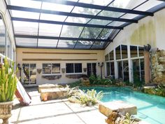 Private screened lanai at 1405 King Sago Ct, Naples, FL 34119. 4 bedroom + den, 3 bath, CB/stucco home located on a cul-de-sac on a 0.24 acre lot in the gated Saturnia Lakes community of Naples. Click on this pin for more information! #naples #realestate