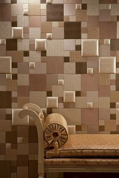 Padded faux leather tiles will provide an added depth to a room.