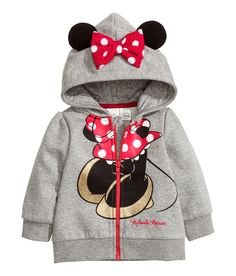 Let a little one be Minnie for a day in this graphic zip-up hoodie complete with a set of ears. | H&M Kids
