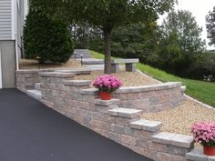 Segmental Retaining Walls made with strong, interlocking,  segmental concrete blocks, replace timber walls with great results - After