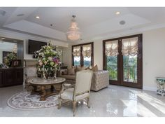Walk inside to the house to the formal foyer with high ceilings.