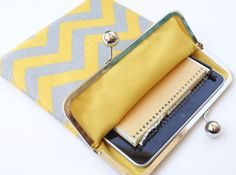 Chevron iPad Case or Sleeve with Kisslock Frame - iPad Case or Clutch - Notebook Clutch - Yellow and Gray Chevron Print Linen. $49.99, via Etsy.