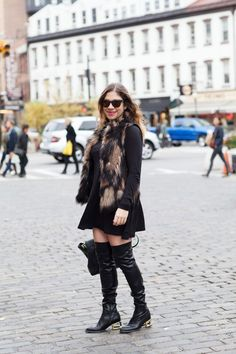 Over-the-knee boots can transform even the most simple black dresses into something more interesting.