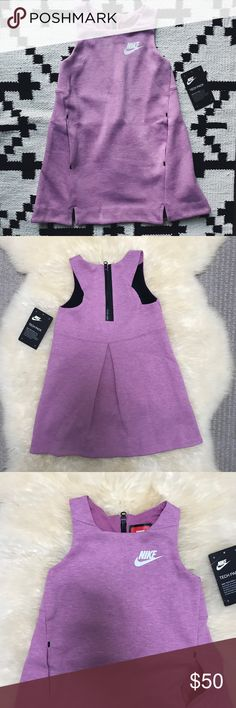 "Nike Girls Tech Fleece Orchid Heather Dress •Heathered orchid Nike tech fleece dress. Two pockets on the front of the dress. 67% cotton, 33% polyester.  •Girls Size 4/XS, Length from shoulder to hem 20"", pit to pit 10"". Could also fit a 3T it would just be more of a maxi dress.  •New with tag.  •No trades, no holds. Nike Dresses Casual"