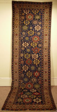 Antique Kuba shirvan blossom runner with green kufic border ca 1880 or before. size 337 x 117 cm. All wool and natural dyes no fuchsine as is often found in these pieces so  ...
