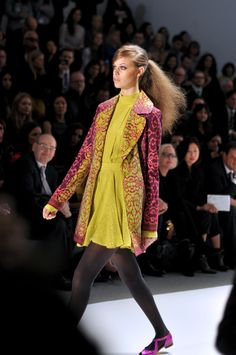 Nanette Lepore's fall show was stunning! The teased ponytail, the rich colors of the dress and jacket and the bright pop from the shoe have us wanting this whole look!