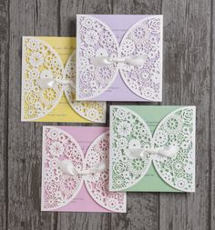 Vintage lace laser cut personalised wedding invitations. Purple, yellow, green and pink inserts.