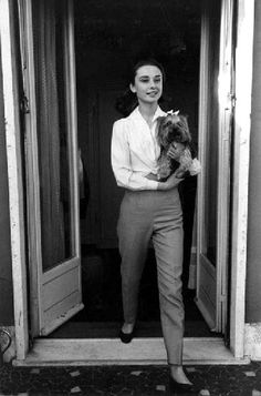 Audrey Hepburn with her dog. Pin of the day(late): 5/18/16.