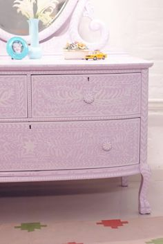 """Painting a dresser with an """"inlay"""" pattern."""