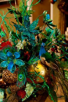 Show Me Christmas Decorating, Show Me Decorating Christmas trees, mantels, wreaths, garlands, doorways and more, Peacock centerpiece with a ...