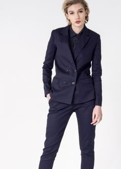 Constructed in comfy stretch material, this double breasted blazer has a structured boxy fit and slim tailored sleeves. Pair it with fitted slacks or oversized trousers for versatile menswear style.
