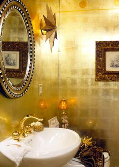 Wouldn't this be sharp for a downstairs guest bathroom? The gold paper has such a regal effect.
