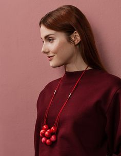 Three layers of wooden pearls bring the Malla necklace a sense of abundance and form a beautiful continuation of the delicate string. The necklace is available in stylish black, festive red or a light shade. Designer Marianne Siponmaa. Wood, jewellery metal, polyester cord, length 80 cm. Handmade in Finland.