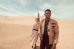 This cosplaying couple has taken cuteness to galactic extremes with a recent Star Wars-inspired photoshoot. Victor Sine and Julianne Payne made a four-hour trek to the Jakku-like backdrop of Utah's Little Sahara Sand Dunes, where photographerRobert Lance captured them in epic portrayals of the film saga's beloved Finn and Rey. Though fans can only speculate on the romantic relationship between the movie's characters, the real-life pair are engaged to be married in May. They first fell in…