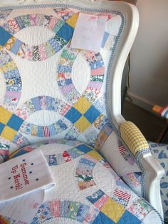 Chair reupholstered with a vintage quilt - what a wonderful way to reuse and recycle