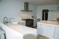 Another stylish #kitchen #design from one of our residential projects in #corian whitecap with an integrated sink.
