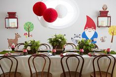 woodland gnome party, fern centerpieces, moss runner, red and white accents